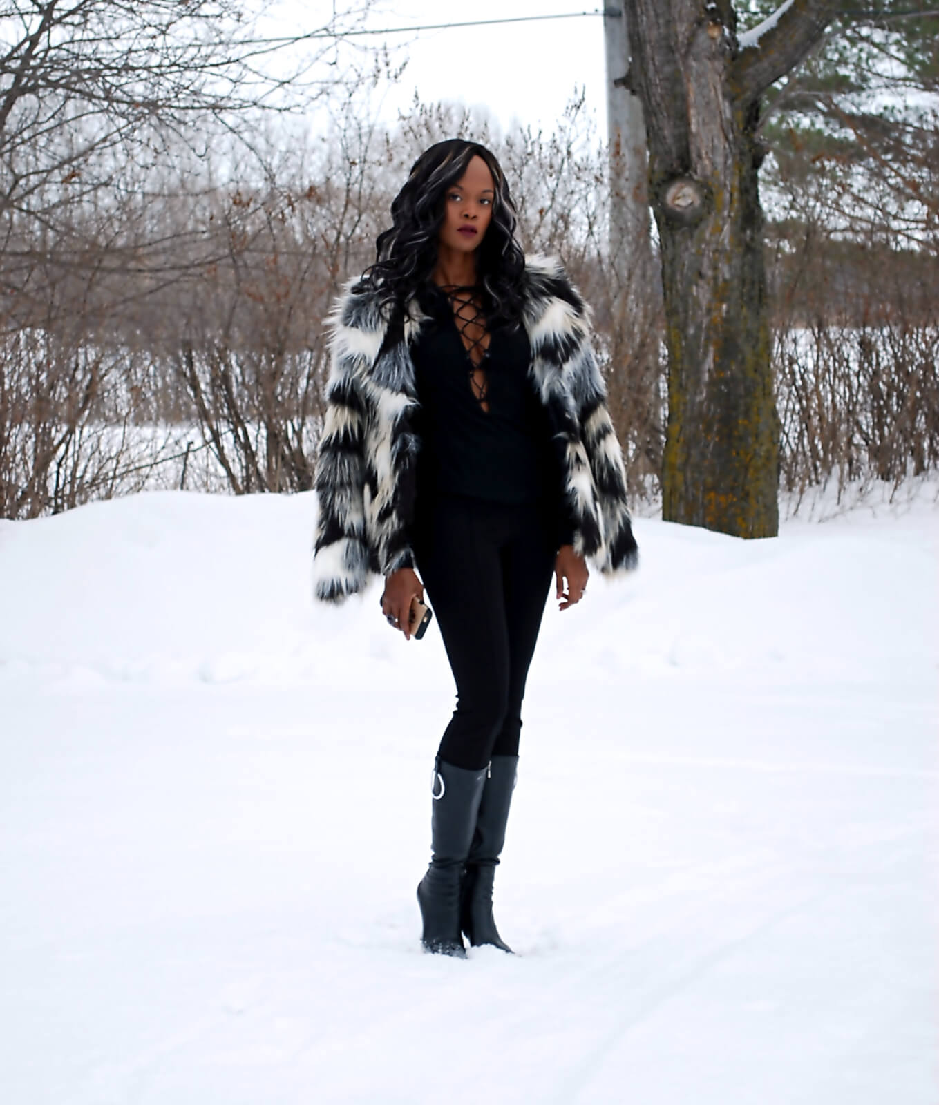 Faux fur coat, Nygard Slims luxe pants, lace up top, winnipeg fashionblogger, Aldo leather black boots, all black outfit, faux fur trend, winter style